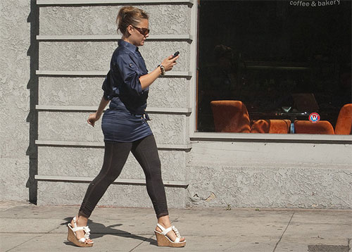 Woman walking while texing